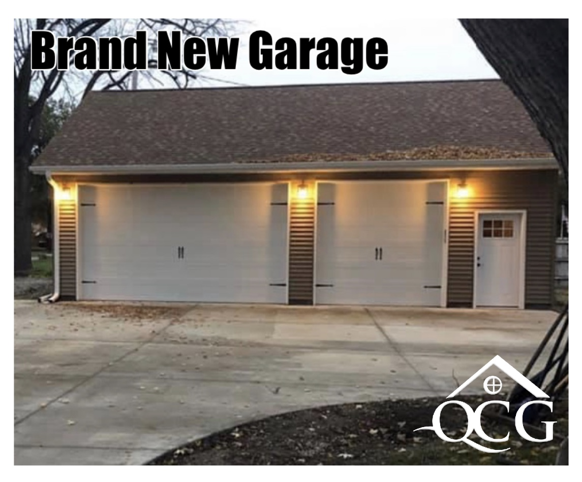 Image of a new garage completed by QC General, including a lighting system, siding, windows, and roofing.